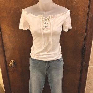 White lace up off the shoulder tee. NWT, medium.
